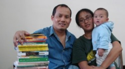 Pastor and family with home library in Far East